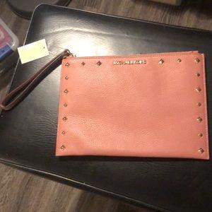 Michael Kors peach/pink wristlet clutch!